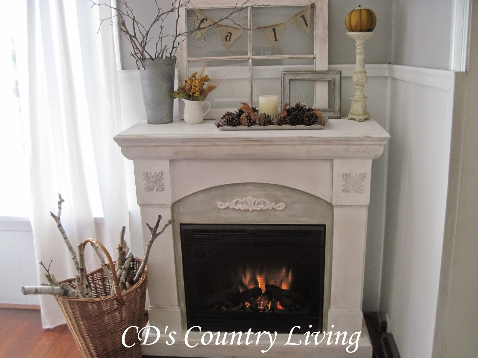 Nothing Fancy Just Some Branches That Fell In Our Back Yard An Old Window Frame From The Farm A Candle With Pine Cones And Faux Pumpkin Simple